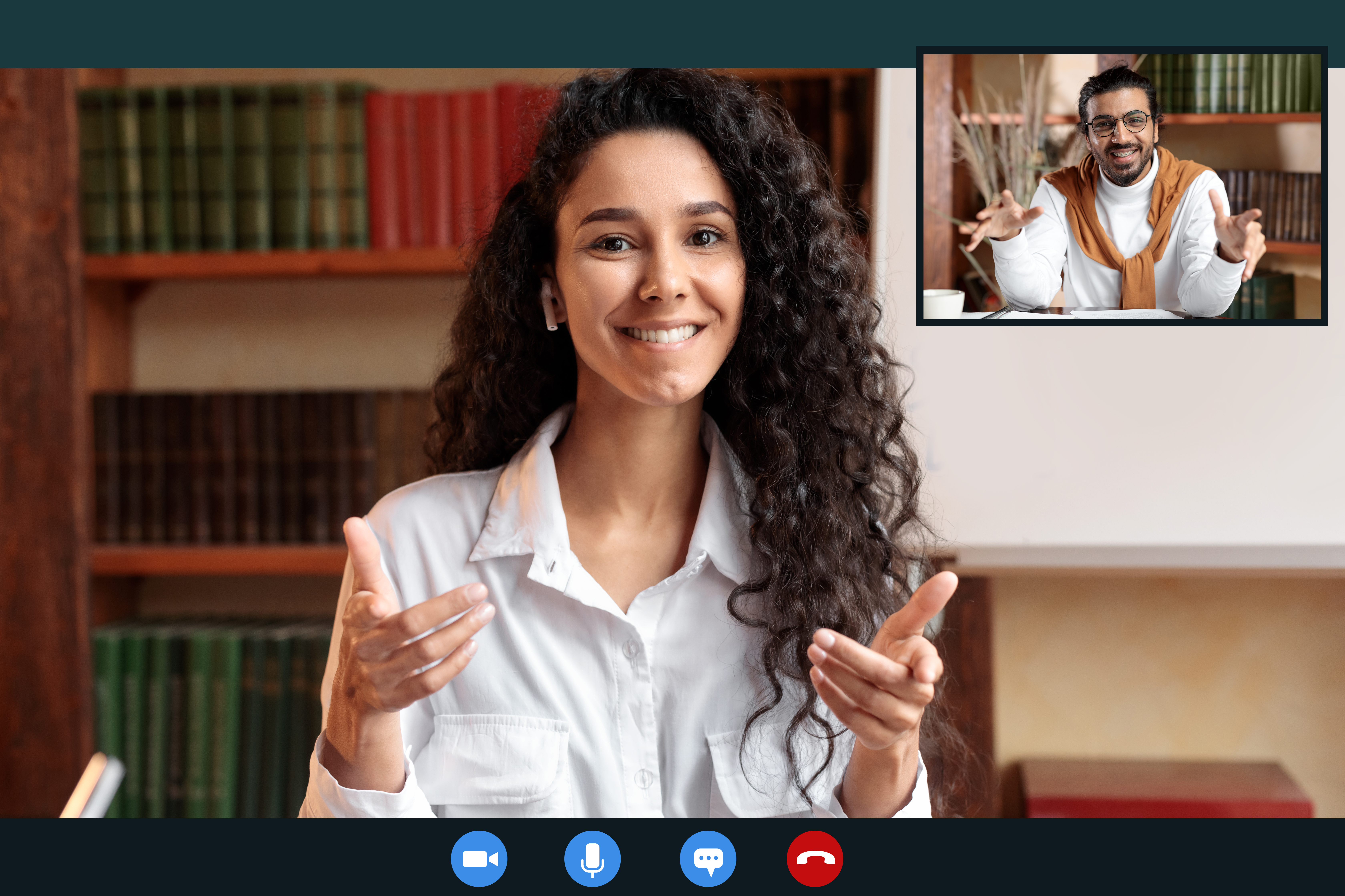 Woman sitting at desk, having online call, talking to camera